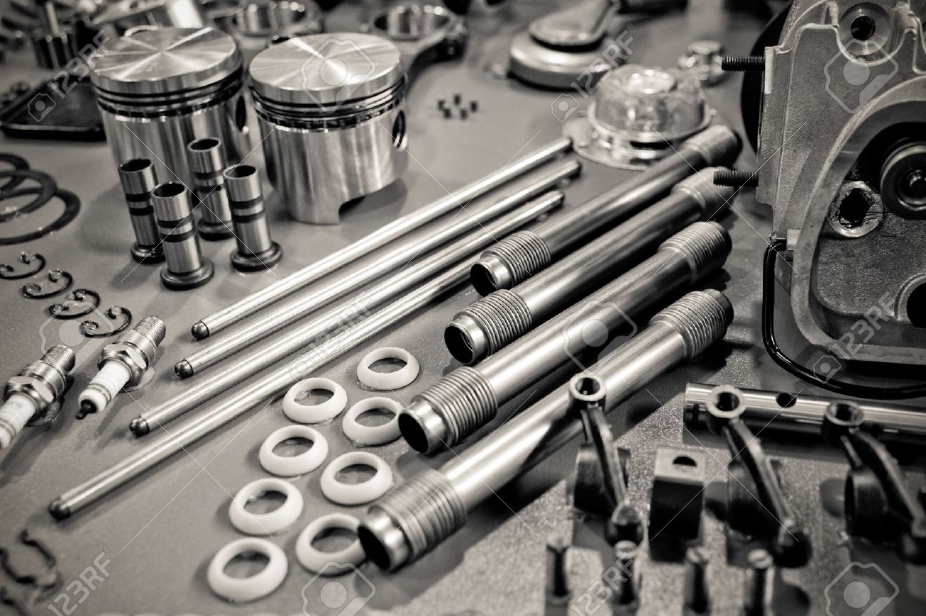 9308201-collection-of-precision-auto-engine-parts-laid-out-in-a-workshop